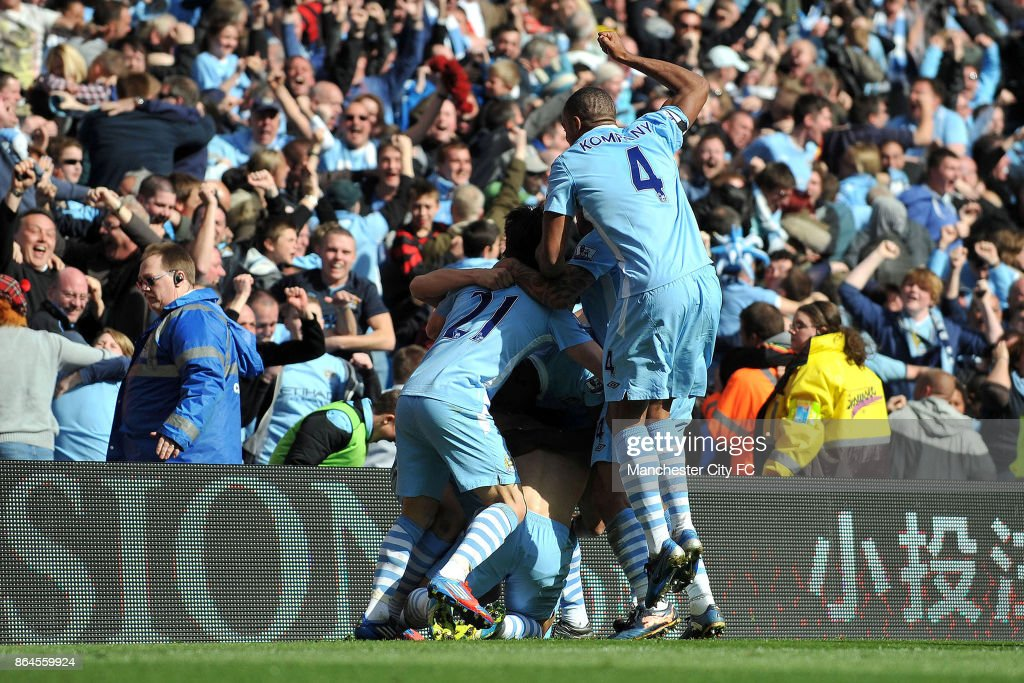 Manchester City's Sergio Aguero (obscured) celebrates with team-mates after scoring the winning goal.