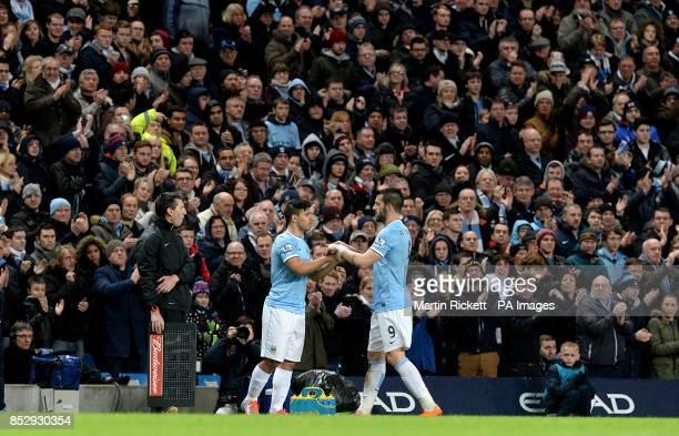 Manchester City's Sergio Aguero comes off the substitutes bench to replace teammate Alvaro Negredo