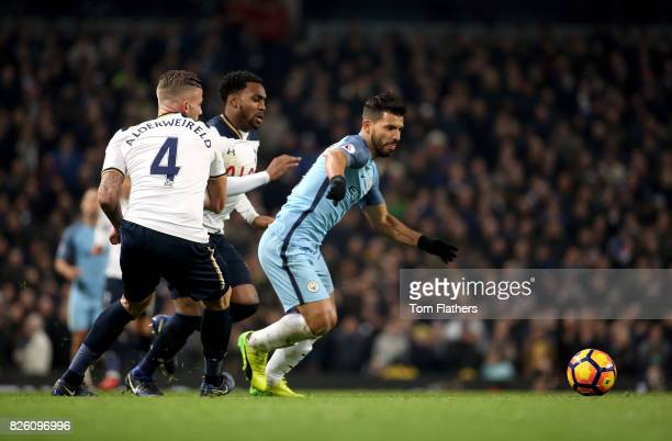 Manchester City's Sergio Aguero gets away from Tottenham Hotspur's Toby Alderweireld and Danny Rose