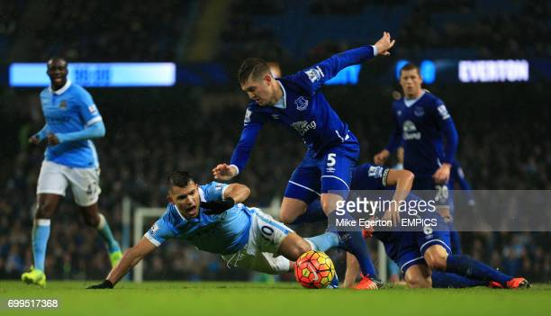 Manchester City's Sergio Aguero goes down in the box after a challenge from Everton's John Stones