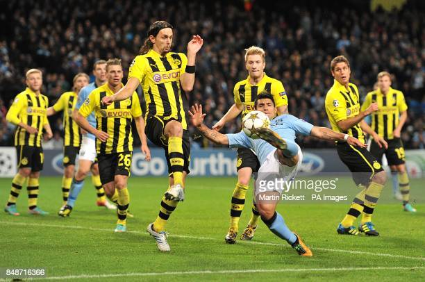Manchester City's Sergio Aguero has a shot blocked by the hand of Borussia Dortmund's Neven Subotic to concede a penalty scored by Mario Balotelli