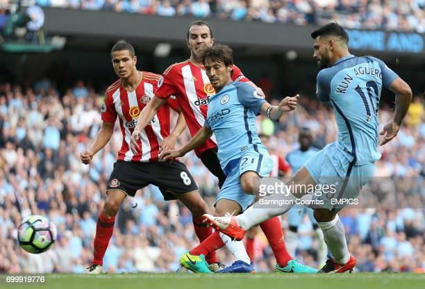 Manchester City's Sergio Aguero has a shot on Sunderland's goal