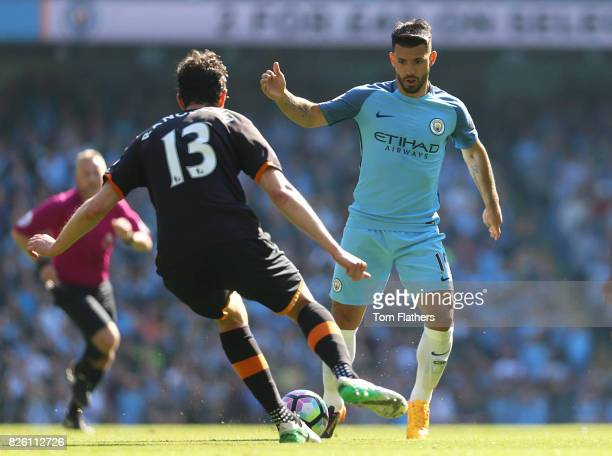 Manchester City's Sergio Aguero in action with Hull City's Andrea Ranocchia