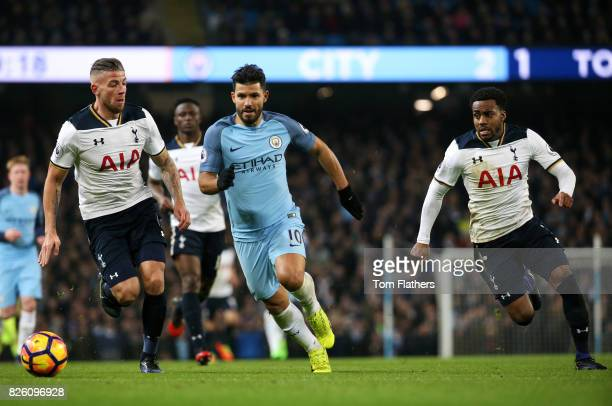 Manchester City's Sergio Aguero in action with Tottenham Hotspur's Toby Alderweireld and Danny Rose