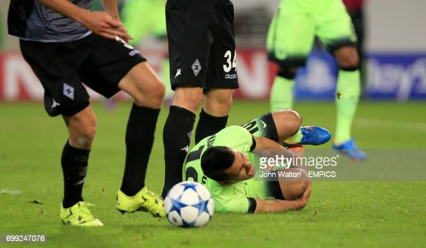 Manchester City's Sergio Aguero injured after being fouled by Borussia Monchengladbach's Fabian Johnson to win his side a penalty
