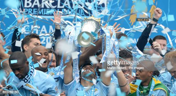 Manchester City's Sergio Aguero lifts the Barclays Premier League trophy following the Barclays Premier League match at the Etihad Stadium Manchester