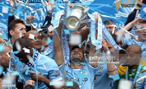 Manchester City's Sergio Aguero lifts the trophy during the Barclays Premier League match at the Etihad Stadium Manchester