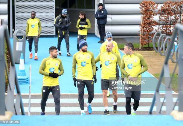 Manchester City's Sergio Aguero Nicolas Otamendi Pablo Zabaleta and Aleksandar Kolarov walk to training
