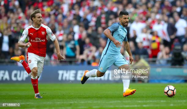 Manchester City's Sergio Aguero on his way to scoring his sides first goal of the match during the Emirates FA Cup Semi Final match at Wembley...
