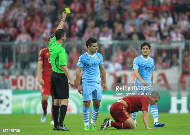 Manchester City's Sergio Aguero receives a yellow card from referee Viktor Kassai