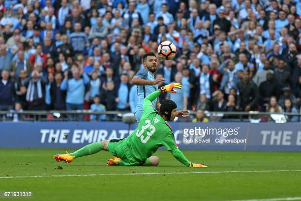 Manchester City's Sergio Aguero scores his sides first goal during the Emirates FA Cup SemiFinal match between Arsenal and Manchester City at Wembley...