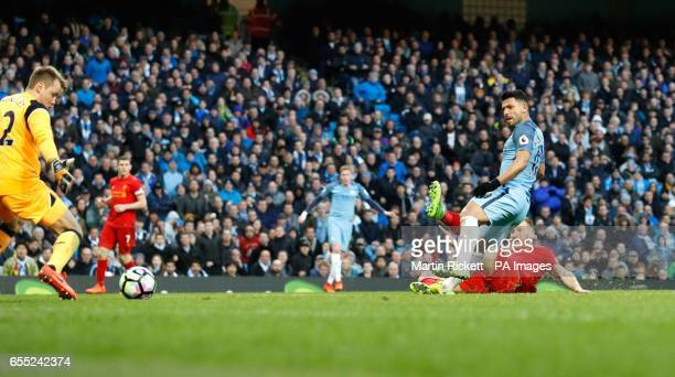 Manchester City's Sergio Aguero scores his side's first goal of the game during the Premier League match at the Etihad Stadium Manchester