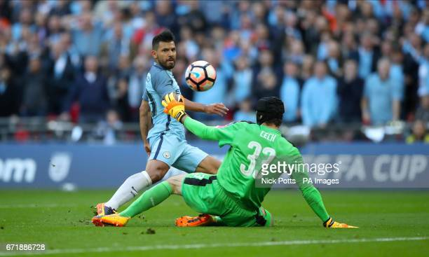 Manchester City's Sergio Aguero scores his side's first goal of the game during the Emirates FA Cup Semi Final match at Wembley Stadium London