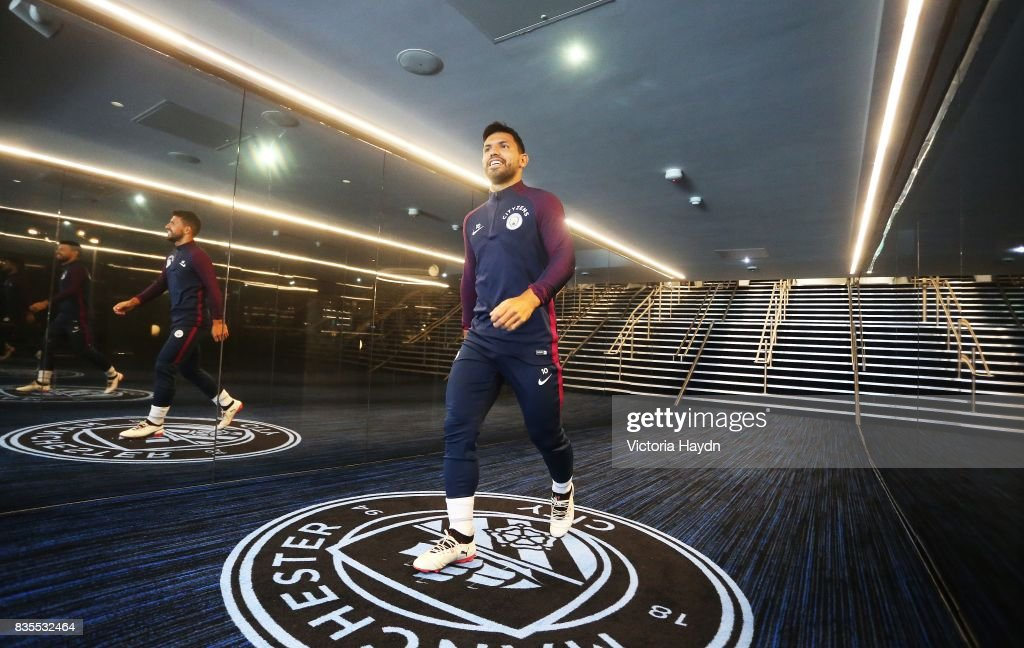 Manchester City's Sergio Aguero walks down the new glass tunnel at Etihad Stadium on August 19, 2017 in Manchester, England.