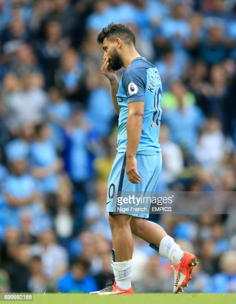Manchester City's Sergio Aguero walks off the pitch dejected as he is substituted