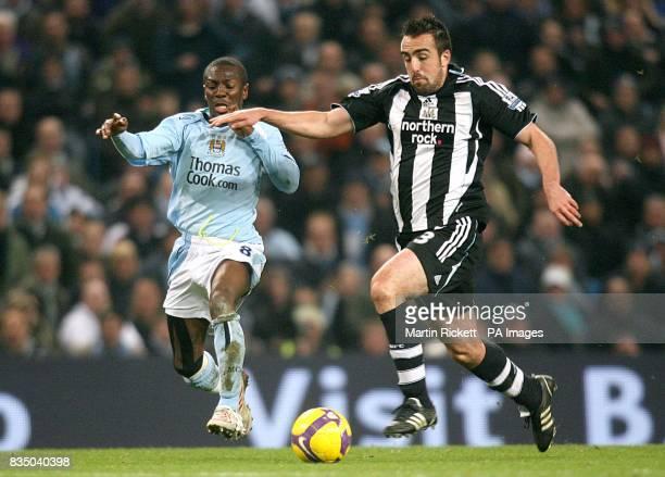 Manchester City's Shaun WrightPhillips and Newcastle United's Sanchez Jose Enrique battle for the ball