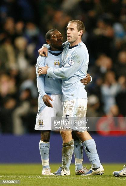 Manchester City's Shaun WrightPhillips and Pablo Zabaleta celebrate victory after the final whistle