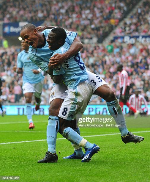 Manchester City's Shaun WrightPhillips celebrates scoring their second goal with teammate Vincent Kompany