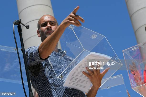 Manchester City's Spanish coach Pep Guardiola carries an electoral urn during a demonstration dubbed 'Referendum is Democracy' organized by ANC AMI...
