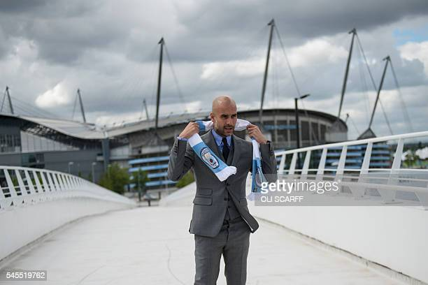 Manchester City's Spanish football coach Pep Guardiola poses for pictures outside the Etihad Stadium in Manchester northern England on July 8 2016...