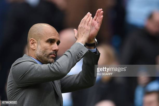 Manchester City's Spanish manager Pep Guardiola applauds the fans following the English Premier League football match between Manchester City and...