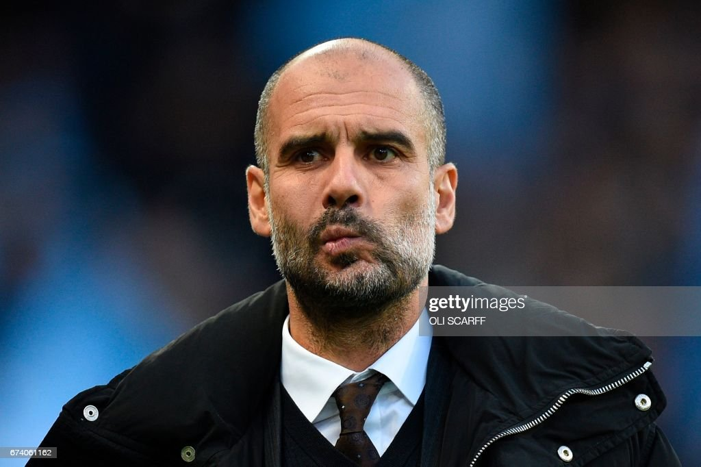 Manchester City's Spanish manager Pep Guardiola arrives for the English Premier League football match between Manchester City and Manchester United at the Etihad Stadium in Manchester, north west England, on April 27, 2017. / AFP PHOTO / Oli SCARFF / RESTRICTED TO EDITORIAL USE. No use with unauthorized audio, video, data, fixture lists, club/league logos or 'live' services. Online in-match use limited to 75 images, no video emulation. No use in betting, games or single club/league/player publications. /