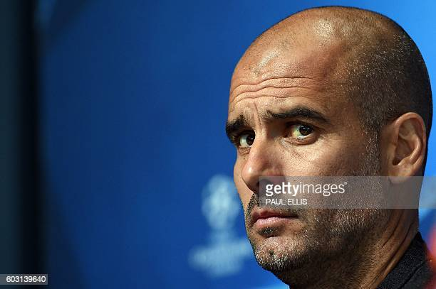 Manchester City's Spanish manager Pep Guardiola attends a press conference at the City Academy training complex in Manchester north west England on...