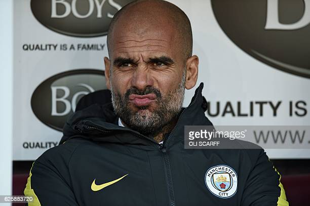 Manchester City's Spanish manager Pep Guardiola awaits kickoff in the English Premier League football match between Burnley and Manchester City at...