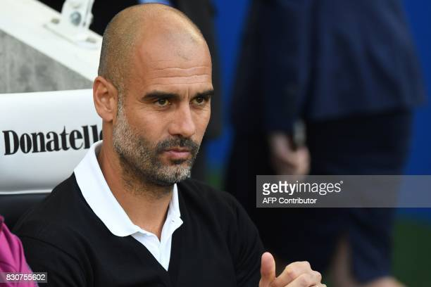 Manchester City's Spanish manager Pep Guardiola awaits kickoff in the English Premier League football match between Brighton and Hove Albion and...
