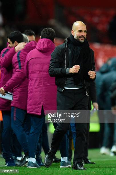 Manchester City's Spanish manager Pep Guardiola celebrates at the end of the English Premier League football match between Manchester United and...