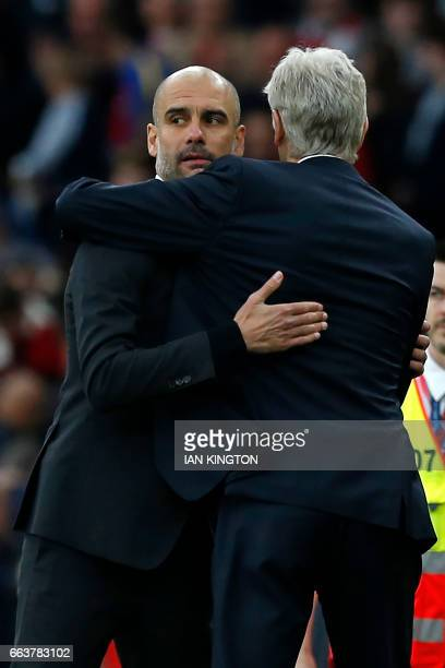 Manchester City's Spanish manager Pep Guardiola embraces Arsenal's French manager Arsene Wenger after the English Premier League football match...