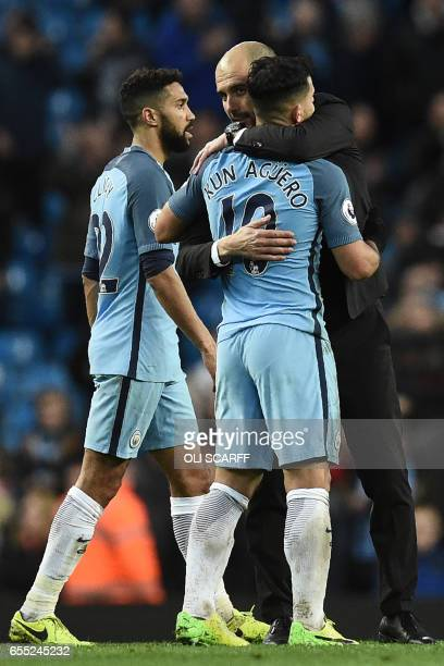 Manchester City's Spanish manager Pep Guardiola embraces Manchester City's Argentinian striker Sergio Aguero on the pitch after the English Premier...