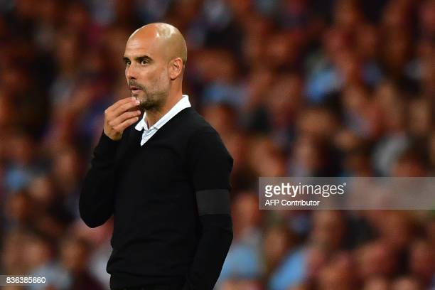 Manchester City's Spanish manager Pep Guardiola gestures during the English Premier League football match between Manchester City and Everton at the...