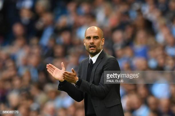 Manchester City's Spanish manager Pep Guardiola gestures from the touchline during the English Premier League football match between Manchester City...