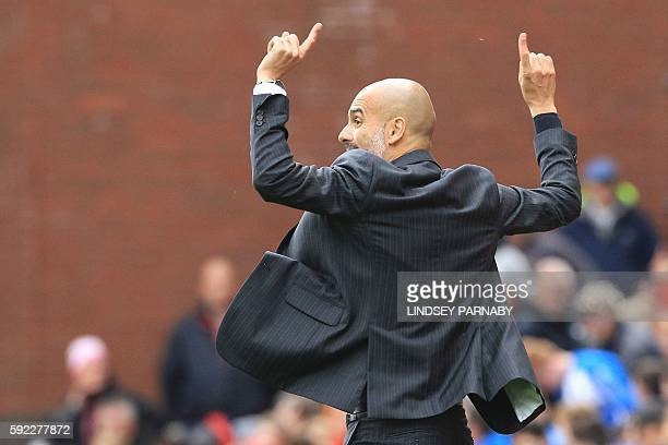 Manchester City's Spanish manager Pep Guardiola gestures from the touchline during the English Premier League football match between Stoke City and...