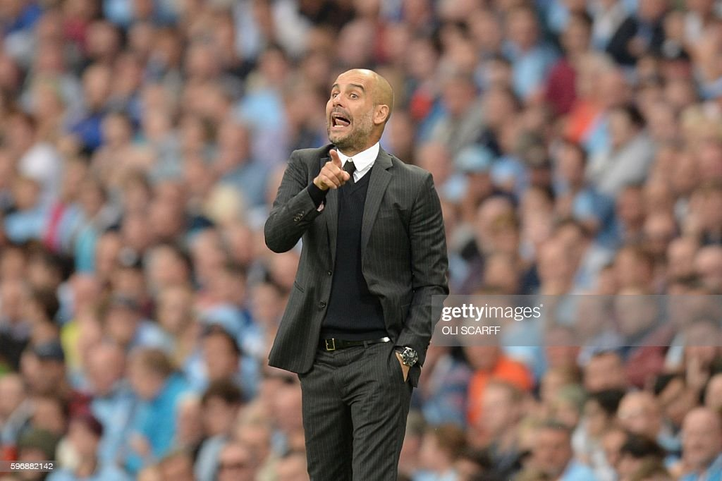 Manchester City's Spanish manager Pep Guardiola gestures from the touchline during the English Premier League football match between Manchester City and West Ham United at the Etihad Stadium in Manchester, north west England, on August 28, 2016. / AFP / Oli SCARFF / RESTRICTED TO EDITORIAL USE. No use with unauthorized audio, video, data, fixture lists, club/league logos or 'live' services. Online in-match use limited to 75 images, no video emulation. No use in betting, games or single club/league/player publications. /