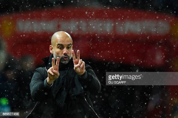 Manchester City's Spanish manager Pep Guardiola gestures from the touchline during the English Premier League football match between Manchester...