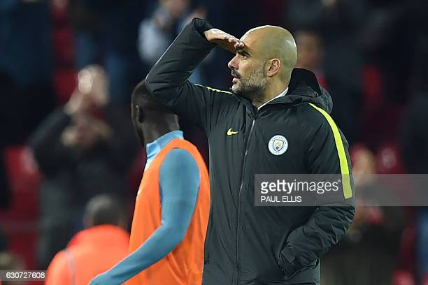 Manchester City's Spanish manager Pep Guardiola gestures on the pitch after the English Premier League football match between Liverpool and...