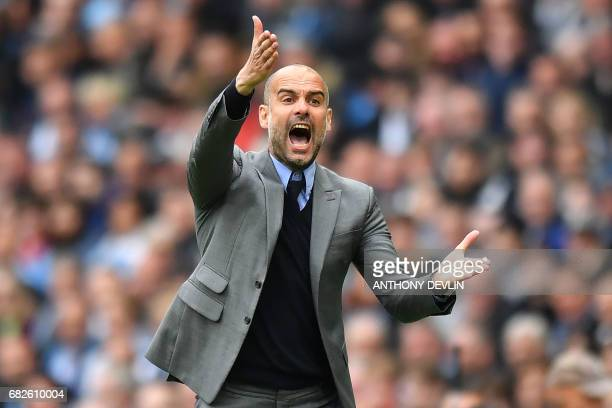 Manchester City's Spanish manager Pep Guardiola gestures on the touchline during the English Premier League football match between Manchester City...