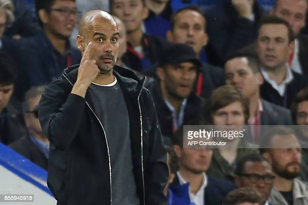Manchester City's Spanish manager Pep Guardiola gestures on the touchline during the English Premier League football match between Chelsea and...