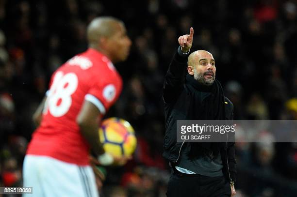 Manchester City's Spanish manager Pep Guardiola gestures on the touchline during the English Premier League football match between Manchester United...