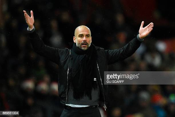 Manchester City's Spanish manager Pep Guardiola gestures on the thouchline during the English Premier League football match between Manchester United...