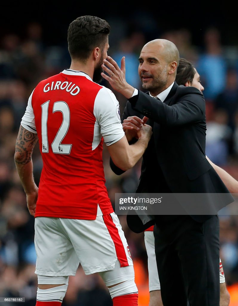 Manchester City's Spanish manager Pep Guardiola gestures to Arsenal's French striker Olivier Giroud (L) on the pitch after the English Premier League football match between Arsenal and Manchester City at The Emirates in London, on April 2, 2017. The game finished 2-2. / AFP PHOTO / IKIMAGES / Ian KINGTON / RESTRICTED TO EDITORIAL USE. No use with unauthorized audio, video, data, fixture lists, club/league logos or 'live' services. Online in-match use limited to 45 images, no video emulation. No use in betting, games or single club/league/player publications.