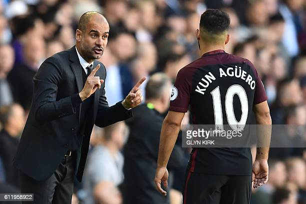 Manchester City's Spanish manager Pep Guardiola gestures to Manchester City's Argentinian striker Sergio Aguero during the English Premier League...