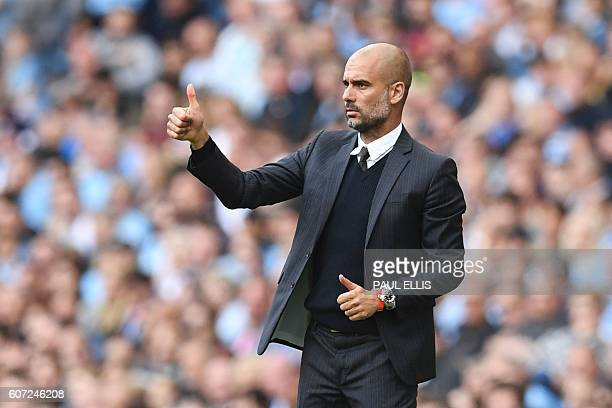 Manchester City's Spanish manager Pep Guardiola gives a thumbs up from the touchline during the English Premier League football match between...