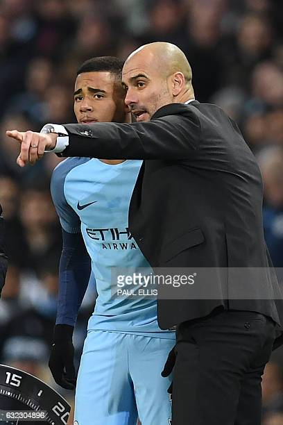 Manchester City's Spanish manager Pep Guardiola gives instructions to Manchester City's Brazilian striker Gabriel Jesus before he come on to make his...