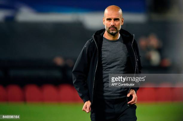 Manchester City's Spanish manager Pep Guardiola looks on after winning the UEFA Champions League Group F football match between Feyenoord Rotterdam...