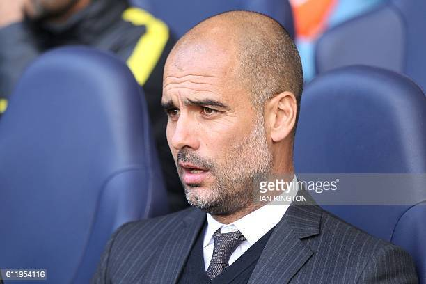 Manchester City's Spanish manager Pep Guardiola looks on ahead of the English Premier League football match between Tottenham Hotspur and Manchester...