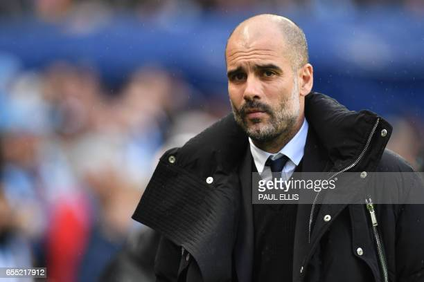 Manchester City's Spanish manager Pep Guardiola looks on before the English Premier League football match between Manchester City and Liverpool at...