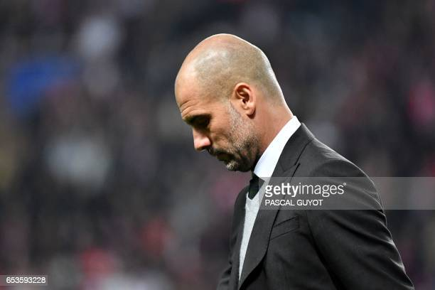 Manchester City's Spanish manager Pep Guardiola reacts during the UEFA Champions League round of 16 football match between Monaco and Manchester City...